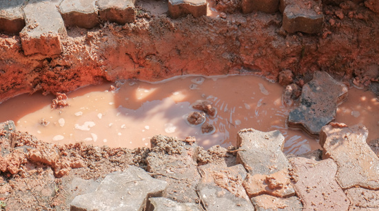 Water main broken by tree root damage in Alpharetta Ga