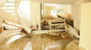 Flooded house with structural and property damage
