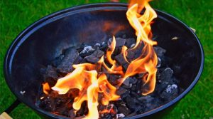 Lighting charcoal in backyard barbecue grill