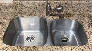 Kitchen sink with side by side basins