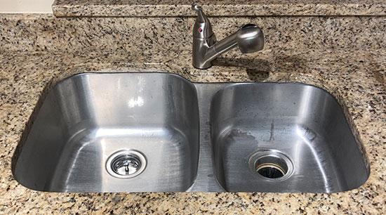 Kitchen sink with side by side basins