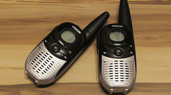Two way radios in emergency evacuation kits for communication