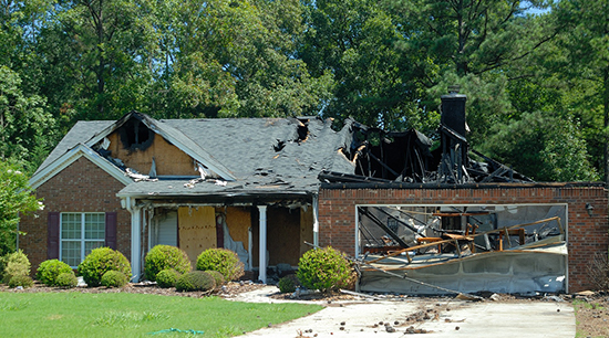Fire and water damage cause severe structural damages after a house burns