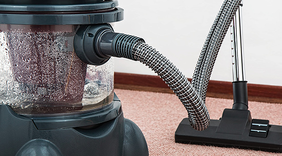 Flood water damage cleanup with vacuums and steam cleaners
